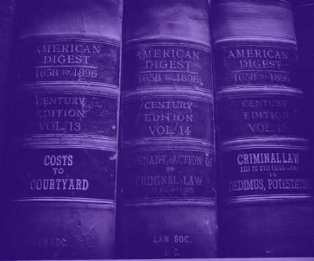 """three old volumes of the law reference book """"american record"""" tinted purple"""