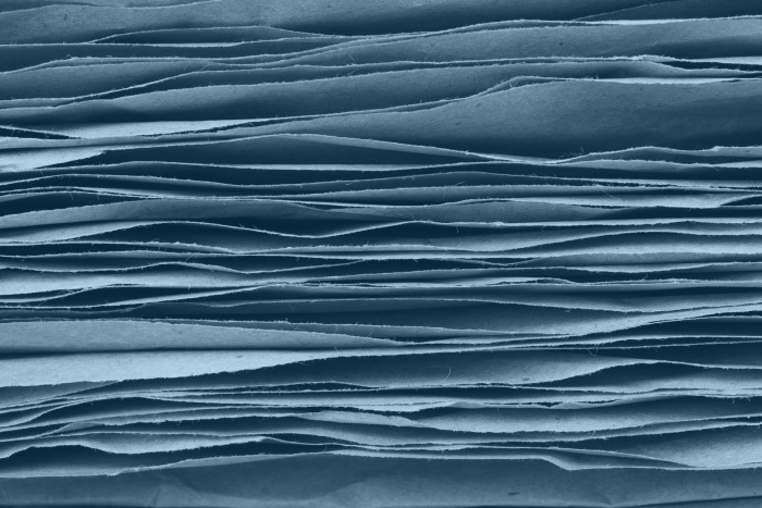 stack of natural fiber pages tinted blue