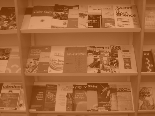 shelves of academic journals tinted orage